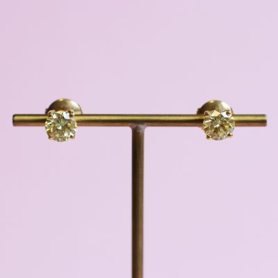 yellow diamond and yellow gold stud earrings