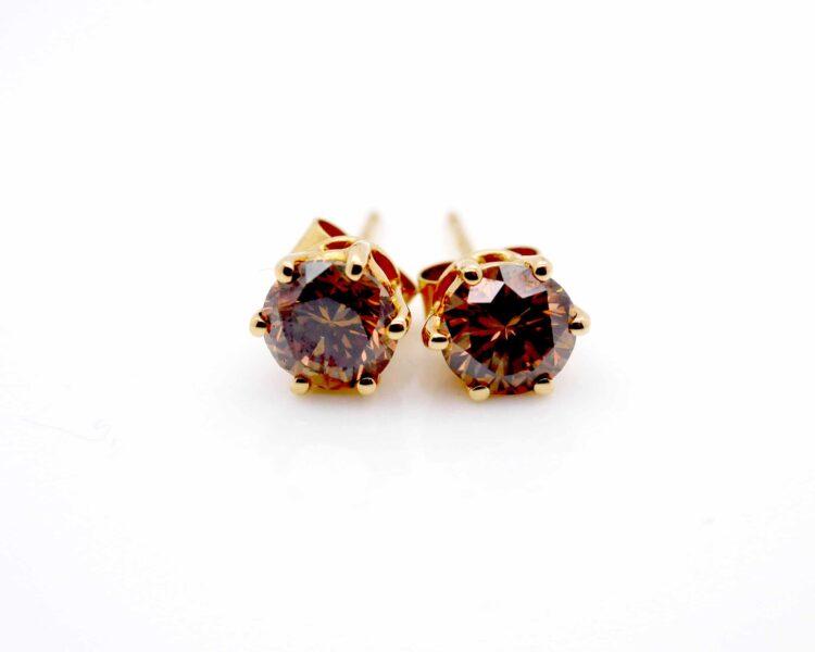 striking brown diamond and yellow gold stud earrings