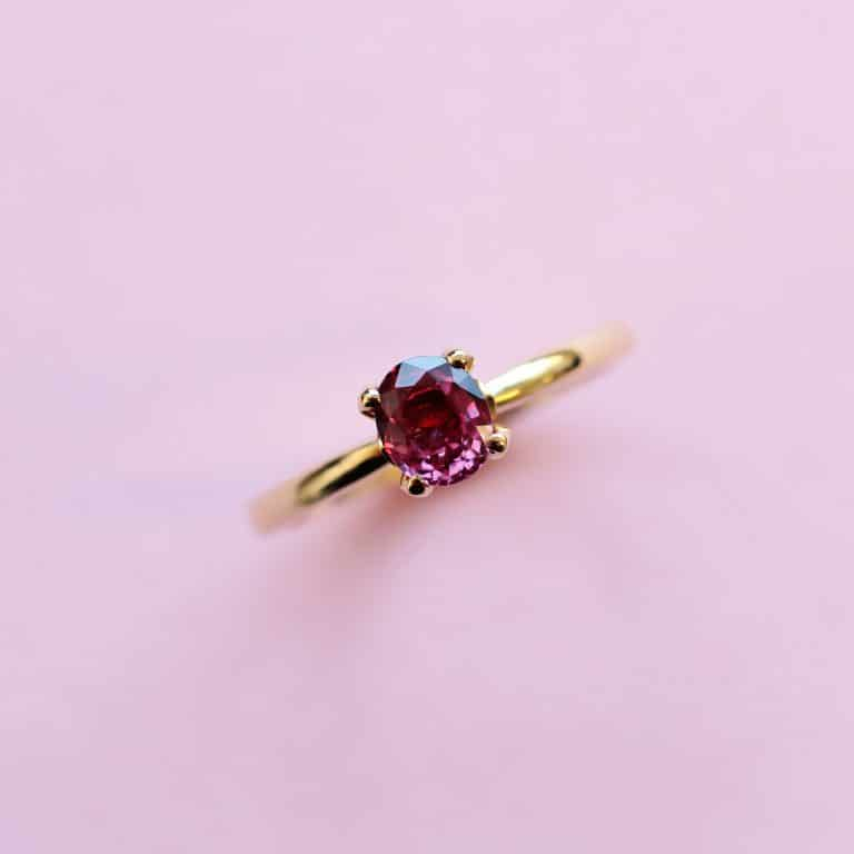solitaire ring set with pinkish red ruby and 18k yellow gold