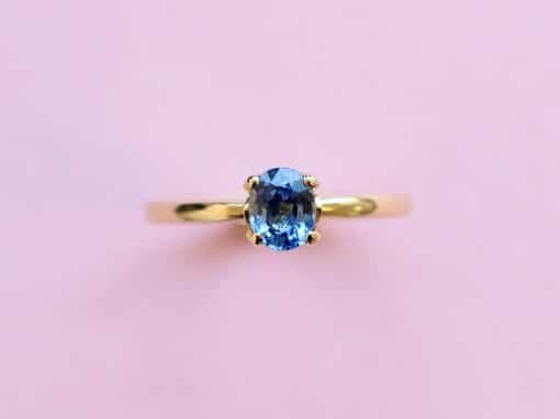 blossom solitaire ring – light blue sapphire and 18k yellow gold