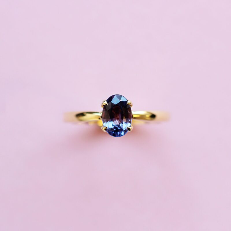 purple sapphire solitaire ring set in 18k yellow gold
