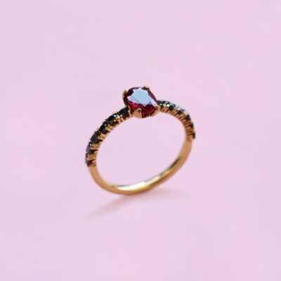 ruby, black diamond solitaire ring set in 18k yellow gold