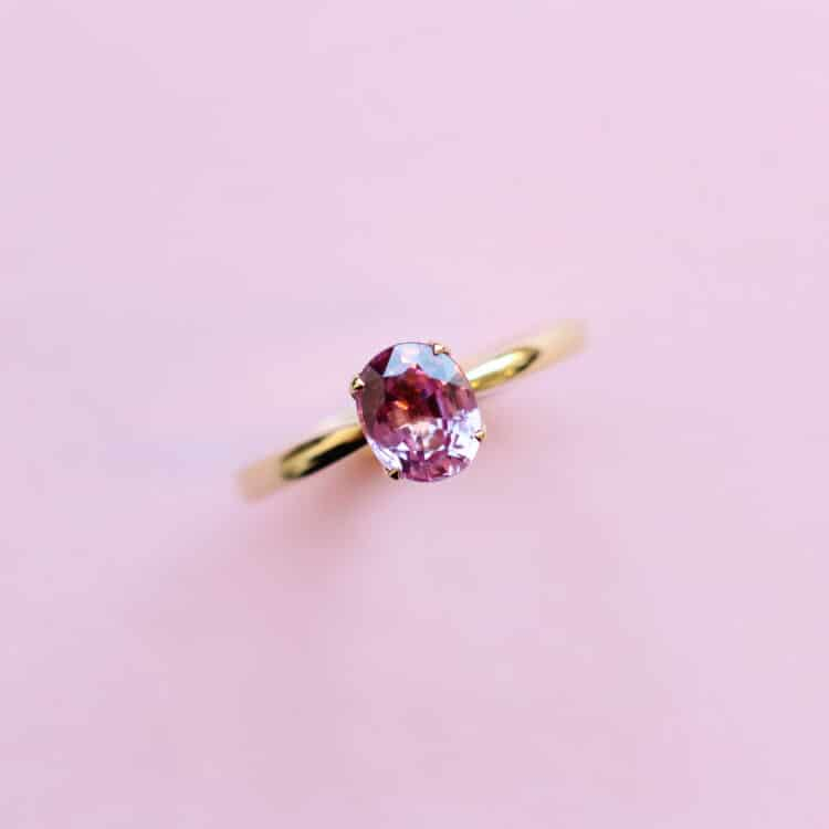 pink sapphire solitaire ring in 18k yellow gold