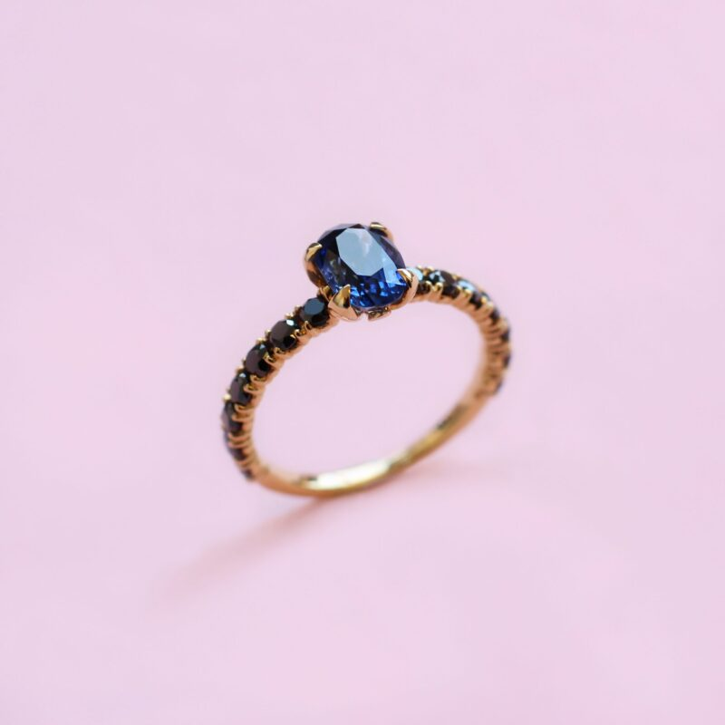 blossom solitaire ring – blue sapphire, black diamond and 18k yellow gold