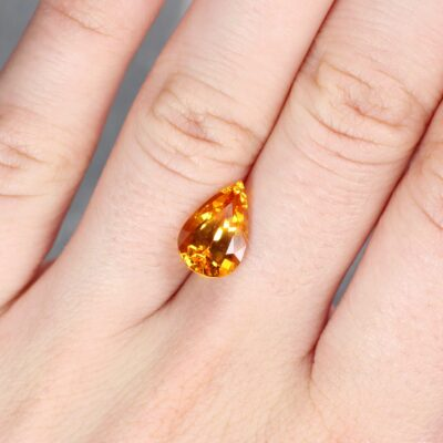4.58 ct yellow orangy pear shape sapphire