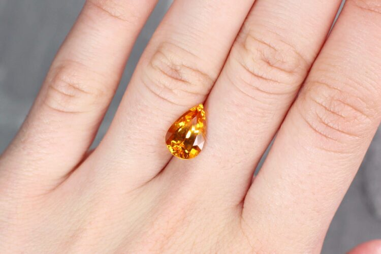 4.58 ct yellow orangy pear shape sapphire