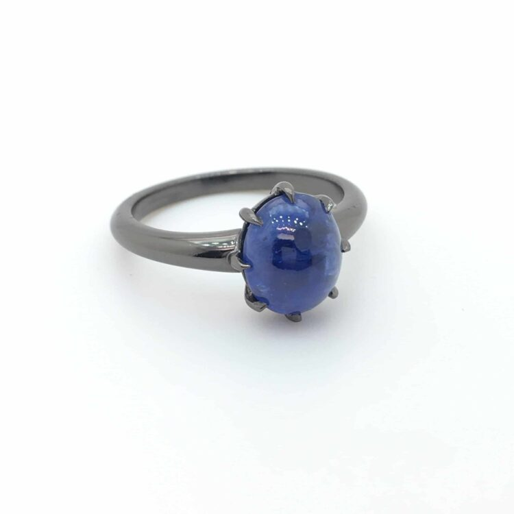cabochon sapphire claw set ring
