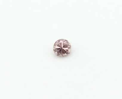0.12ct intense pink round diamond